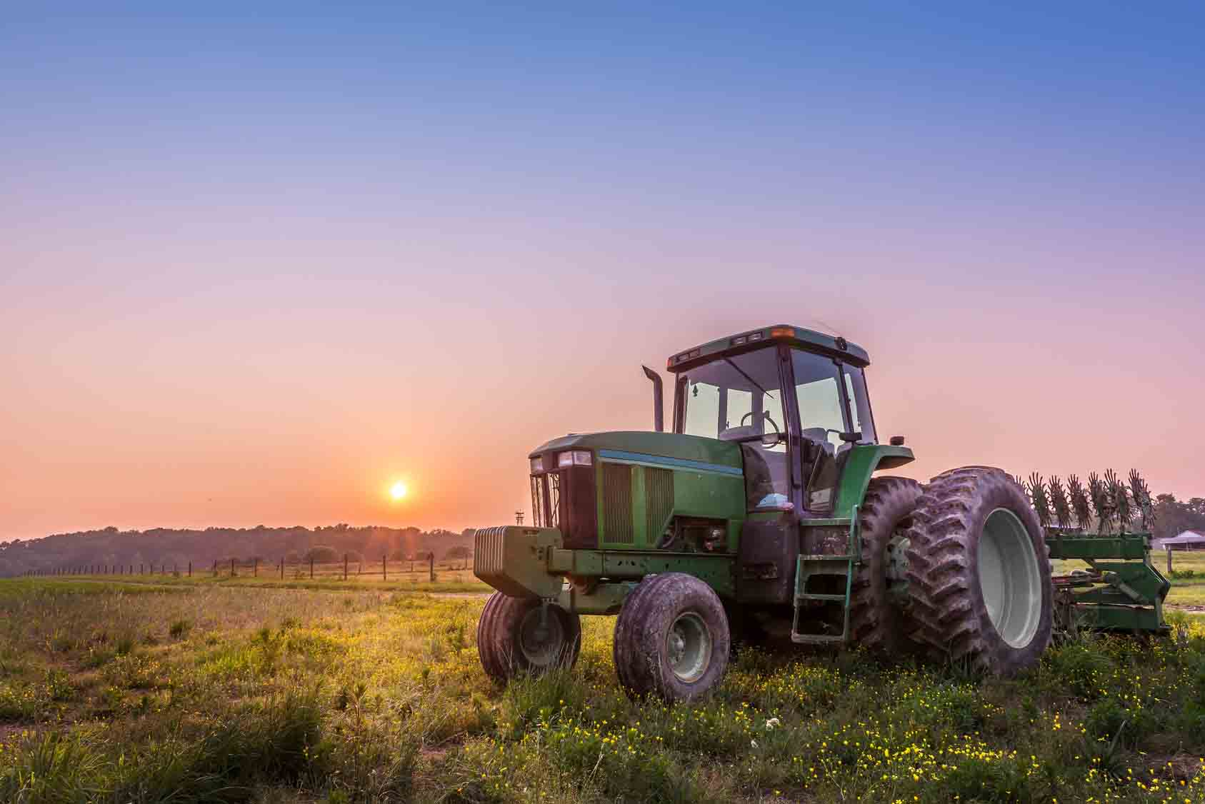 Farm Tractor in a field on a Maryland Farm at sunset